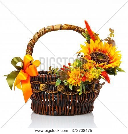 Original Dark Brown Wicker Basket With Floral Arrangements. Great Scenery With Yellow Flowers, Green