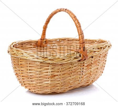 Oval Brown Wicker Basket Made Of Natural Vine. Isolated.