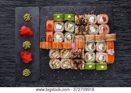 Japanese Sushi Food. Maki Ands Rolls With Tuna, Salmon, Shrimp, Crab And Avocado. Top View Of Assort