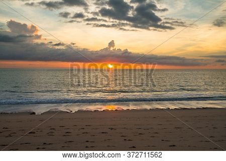 Beautiful sunset on the beach of Andaman Sea, Thailand