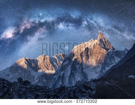 Arched Milky Way Over The Beautiful Mountains At Night In Himalayas, Nepal. Colorful Space Landscape