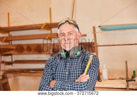 Old craftsman Master as a carpenter with experience and competence