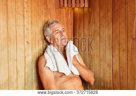 Senior man sweats in the steam sauna in the hotel spa during a wellness holiday