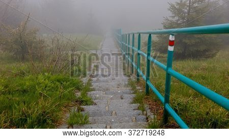 Red Tourist Walking Path Marker On Outdoor Stairs Railing On A Foggy Day, Dlouhe Strane,jeseniky, Cz