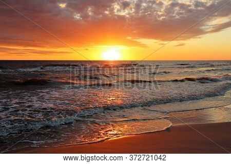 Beach And Seascape On The Background Of A Picturesque Sunset.