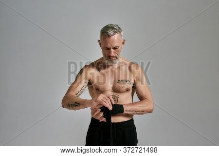 Half Naked Middle Aged Athletic Man, Kickboxer Wrapping Hands For Muay Thai, Boxing Or Kickboxing, S