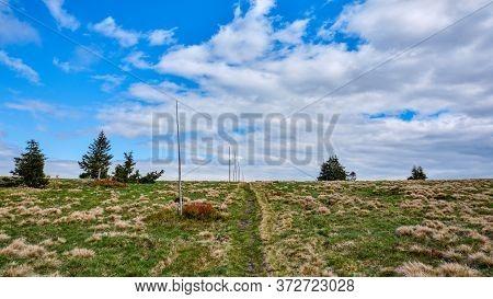 Walking Path Marked With Poles Leading Towards The Horizon, Jeseniky Mountains, Czech Republic.