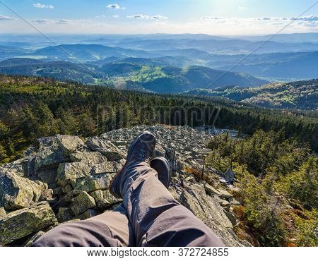 View Over Beautiful Colorful Landscape During Sunset With Hikers Boots In The Picture Sitting On Hug