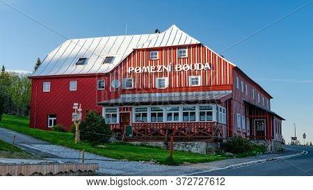 Pomezni Boudy, Horni Mala Upa, Czech Republic - June 01, 2020: Classic Red Wooden Mountain Hut With