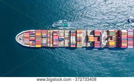 Aerial Top View Of Cargo Ship Carrying Container And Running For Export  Goods  From  Cargo Yard Por