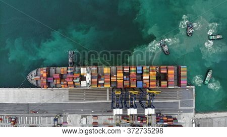 Tugboat Working In The International Terminal Yard Port Prepare Cargo Container Ship To Ready For Ce