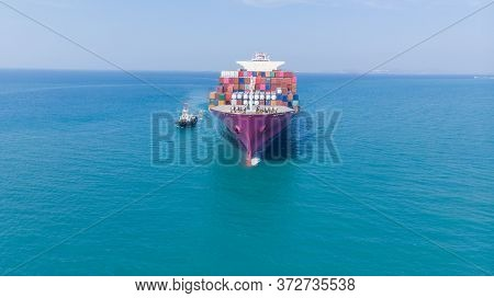 Aerial Of Cargo Ship Carrying Container And Running For Export  Goods  From  Cargo Yard Port To Othe