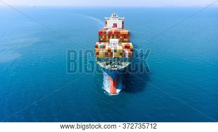 Aerial Infront Of Cargo Ship Carrying Container And Running For Export  Goods  From  Cargo Yard Port