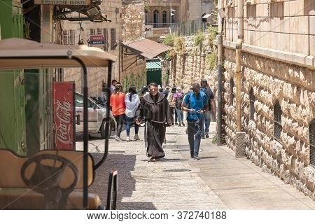 Jerusalem, Israel, June 13, 2020 : A Priest And A Tourist Walk And Talk Along Via Dolorosa In The Ar
