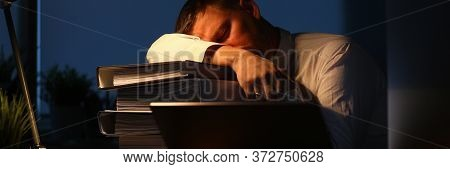 Portrait Of Hardworking Businessman Sleeping On Big Pile Of Important Paper Folder Full Of Documents