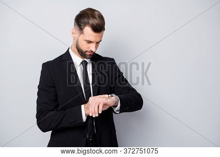 Portrait Of Serious Concentrated Man Appoint Meeting With His Clients Wait Check Time On Wrist Watch