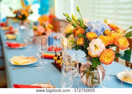 Vase With Flowers On A Festive Table. The Decoration Of A Celebratory Banquet.