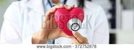 Hands Of Female Gp Holding Stethoscope Head Near Red Toy Heart As Cardiac Problems Prophylaxis And R