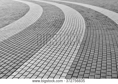 Circle Tile Road. Stone Pavers In City Park. Paving Stones For Walkways And Sidewalk. Outdoor Surfac