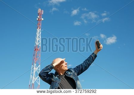 Man Is Trying To Catch A Mobile Network Signal. 3g 4g Signal Is Very Low.