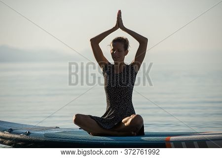 Serene Young Woman Practicing Yoga And Meditation Outside