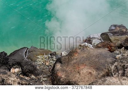 The Edge Of Umi Jigoku Pond(blue Sea Water Hell) Is One Of Eight Beppu Hot Spring (onsen). The Most