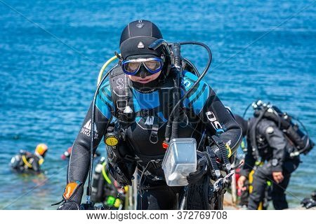Malmö, Sweden - June 14, 2020: Scuba Divers Return After A Scuba Dive In The Cold  Water Of Oresund