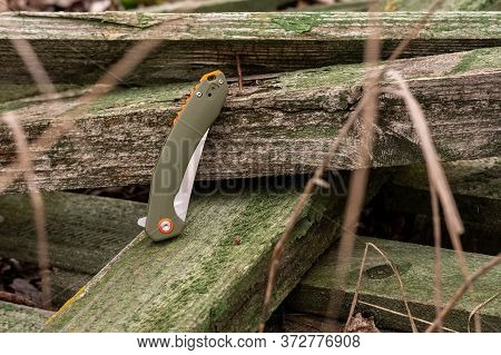 Folding Knife In The Folded Position. Blade Of A Knife Hidden In The Handle.