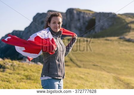 Canadian National Holiday. 1 July. Happy Canada Day Greeting Card. Young Woman With Canadian Flag.