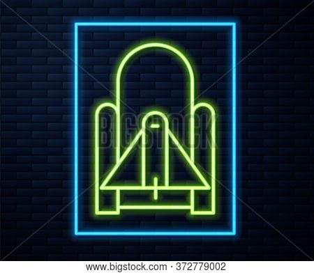 Glowing Neon Line Rocket Launch From The Spaceport Icon Isolated On Brick Wall Background. Launch Ro