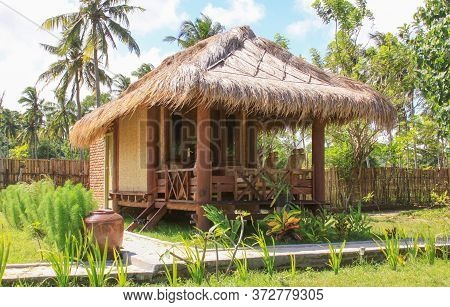 Sasak Bamboo House And Garden In Lombok Resort, Indonesia. Kuta Lombok Is An Exotic Paradise On The