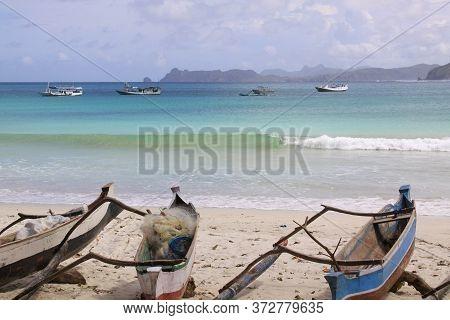 Small Fishing Canoes At Mawun Beach, Lombok. Kuta Lombok Is An Exotic Paradise On The Indonesian Isl