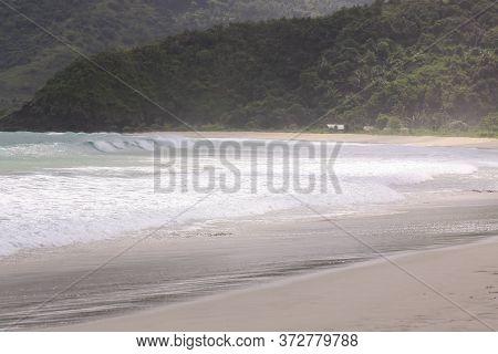 Breaking Surf Waves At Mawun Beach Lombok. Kuta Lombok Is An Exotic Paradise On The Indonesian Islan