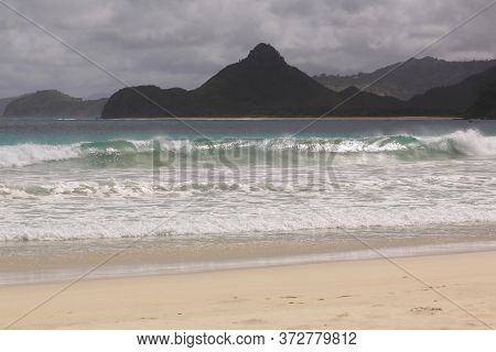 Waves Break At Mawun Beach Lombok, Indonesia. Kuta Lombok Is An Exotic Paradise On The Indonesian Is