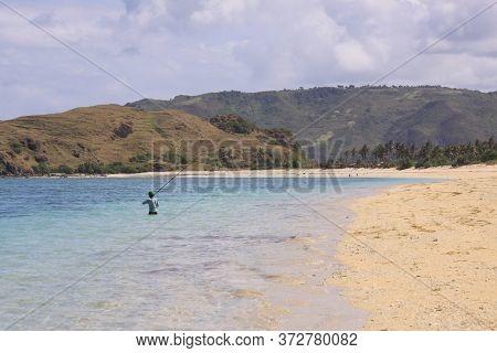 Fisherman On Kuta Lombok Beach. Kuta Lombok Is An Exotic Paradise On The Indonesian Island, With Bea