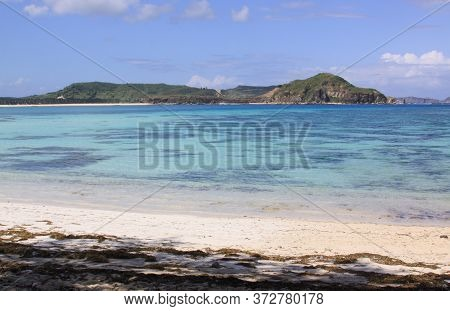 Crystal Clear Water Kuta Beach Lombok, Indonesia. Kuta Lombok Is An Exotic Paradise On The Indonesia