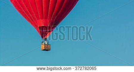 Red Balloon In The Sky. Aerostat. People In The Basket. Fun. Summer Entertainment. Romantic Adventur