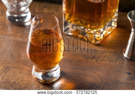 Boozy Amber Whiskey In A Snifter Ready To Drink