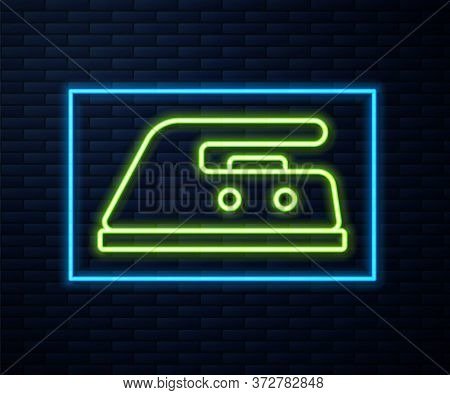 Glowing Neon Line Electric Iron Icon Isolated On Brick Wall Background. Steam Iron. Vector Illustrat