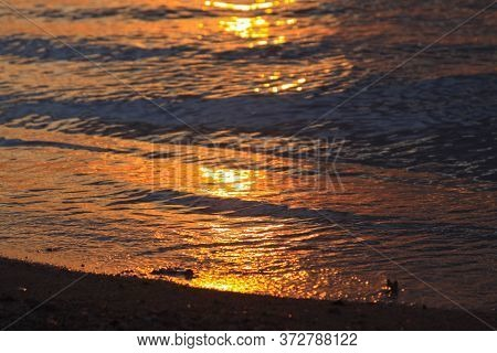 Sun Light Reflected In Sea Waves On Beach At Sunset, On Gili Air Island, Lombok, Indonesia