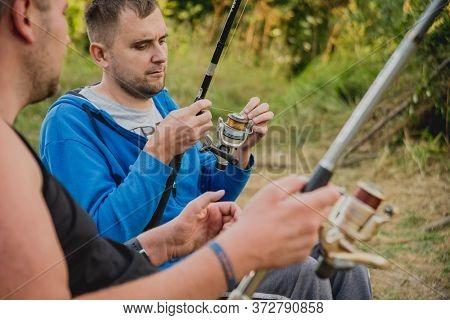 Handicapped Men Fishing At A Lake. Wheelchair. Camping.