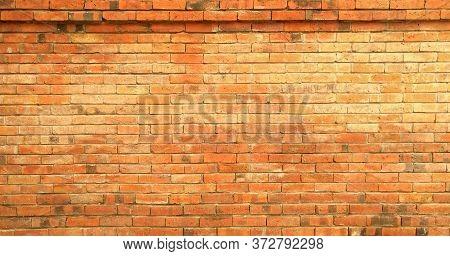 The Orange Brick Wall Pattern Texture Background.