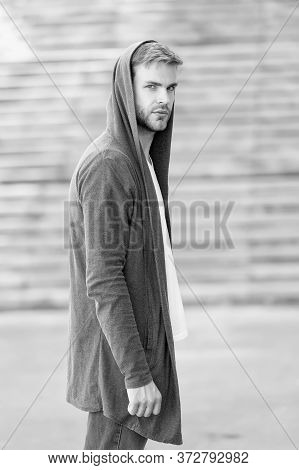 Handsome Man With Hood Standing Urban Background. Fashion Trend. Comfortable Clothes Daily Wear. Gre