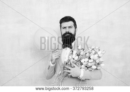 Present For Spouse. Guy With Air Balloon. Birthday Party. Bearded Man Hipster With Flower Bouquet. 8