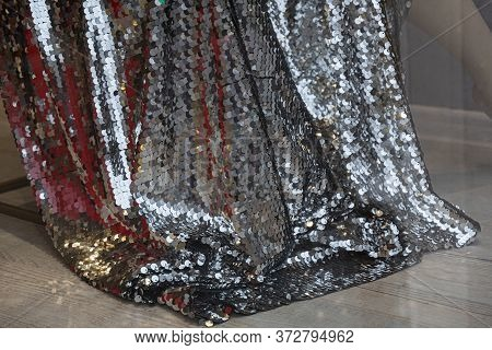 Princess Dress Plume Closeup. Draped Silver Sequins Fabric. Luxury Fashion Glamour Style Clothes Tex