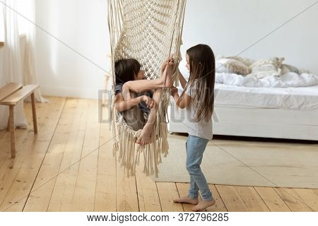 Happy Little Cute Brother And Sister Playing With Hammock.