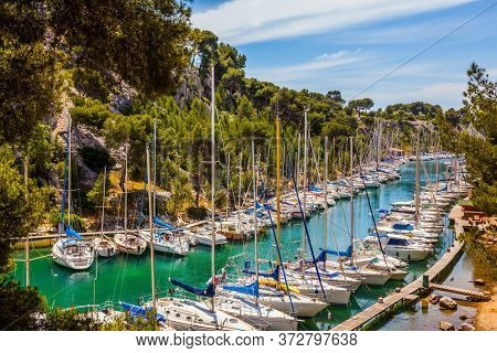Great sailing yachts on the azure water of the south fjord. French coast of the Mediterranean Sea. Calanques are the attractions of Provence. The concept of active and photo tourism