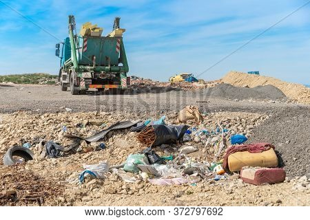 The Garbage Truck Brought The Waste To The Landfill
