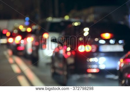 Cars With Headlights On. Signal Lights Of Transport. Line Of Cars On The Road. Traffic Jam In Evenin