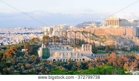 Famous Skyline Of Athens With Acropolis Hill At Sunset, Pathenon, Herodes Atticus Amphitheater And L